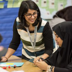 Image of teacher working with a class