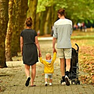 Image of a couple walking with a child