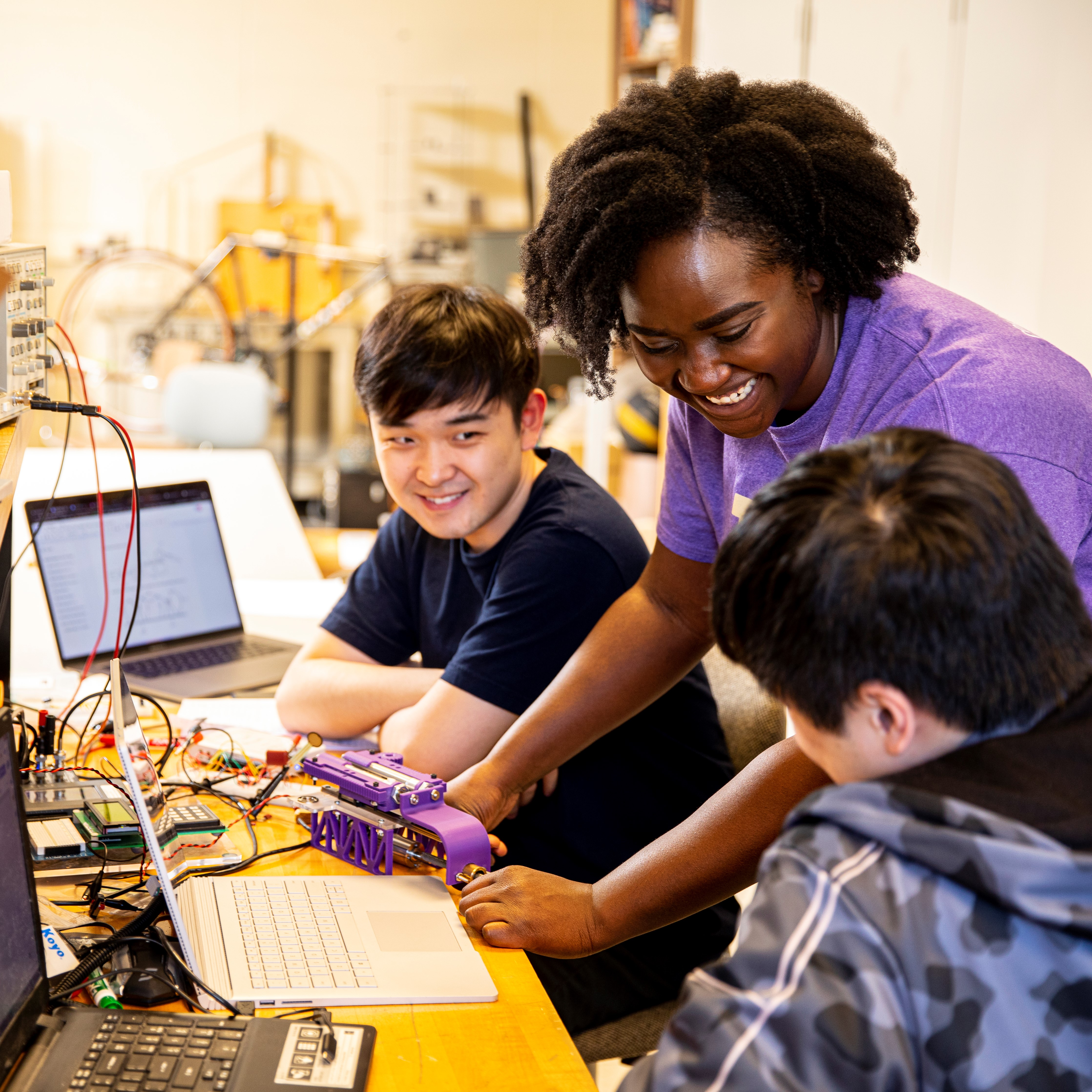 Image of students working on a mechanical engineering project