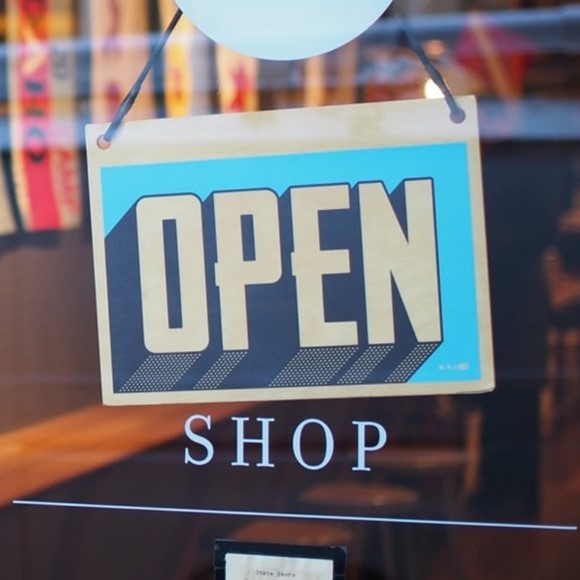 Image of an open sign on the front door of a shop