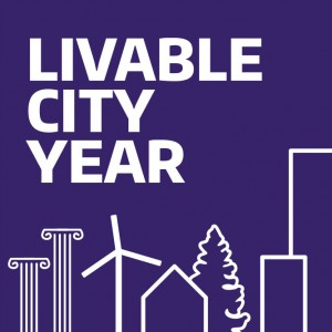 Livable City Year graphic with columns, windmill, buildings and tree