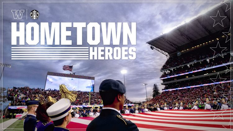 Military members stand during a flag presentation at Husky Stadium
