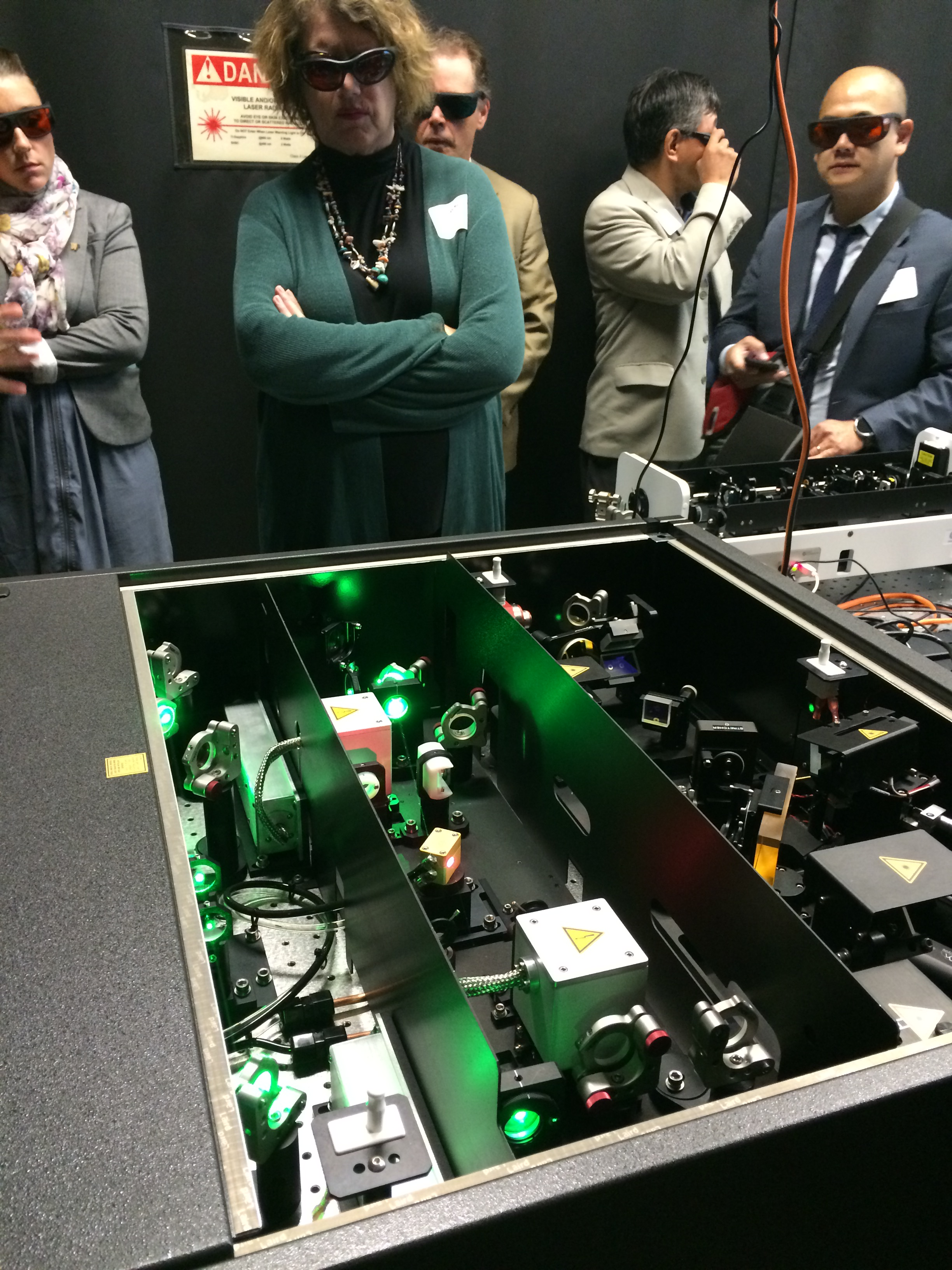 CEI tour attendees get an up close look at a high-powered laser instrument.