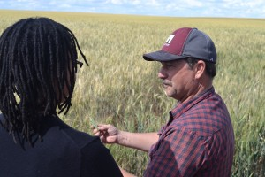 Sen. Mark Schoesler discusses his wheat farm with new UW faculty.