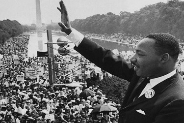 Martin Luther King Jr. waving to a crowd in Washington, DC