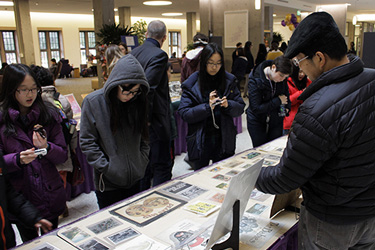 people looking at artifacts laid out on a table
