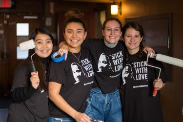 Four people pose for a picture during a MLK Day of Service project