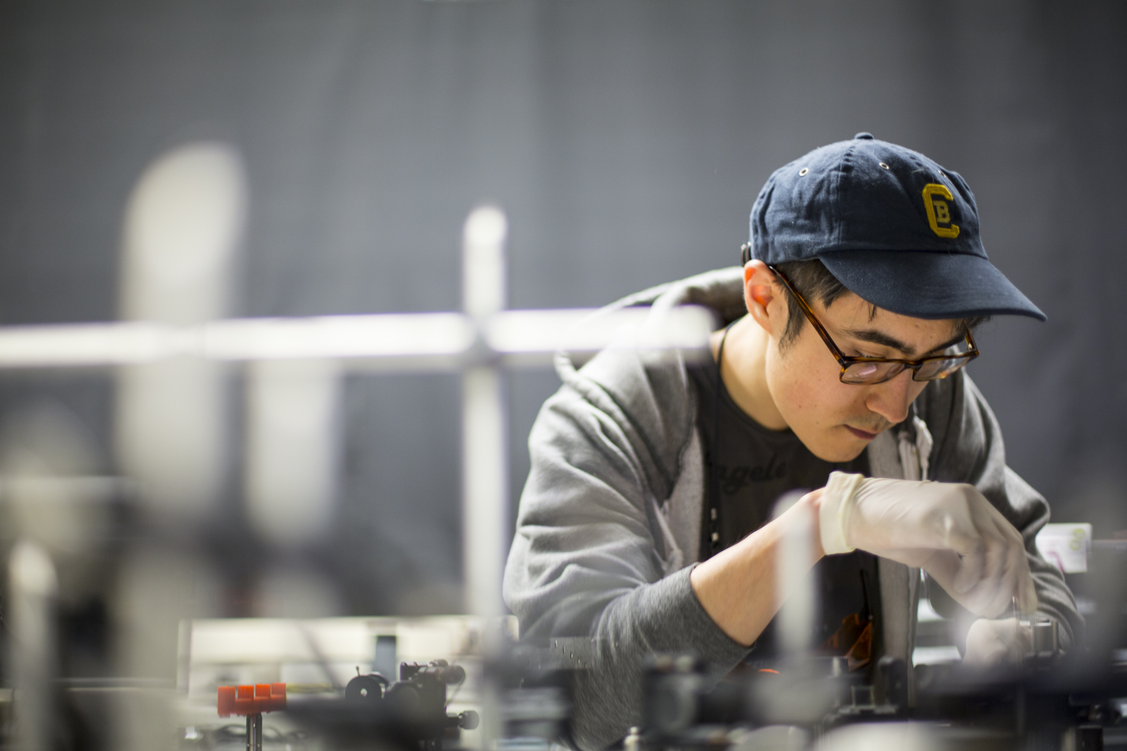 Student working with a mechanical engineering laser
