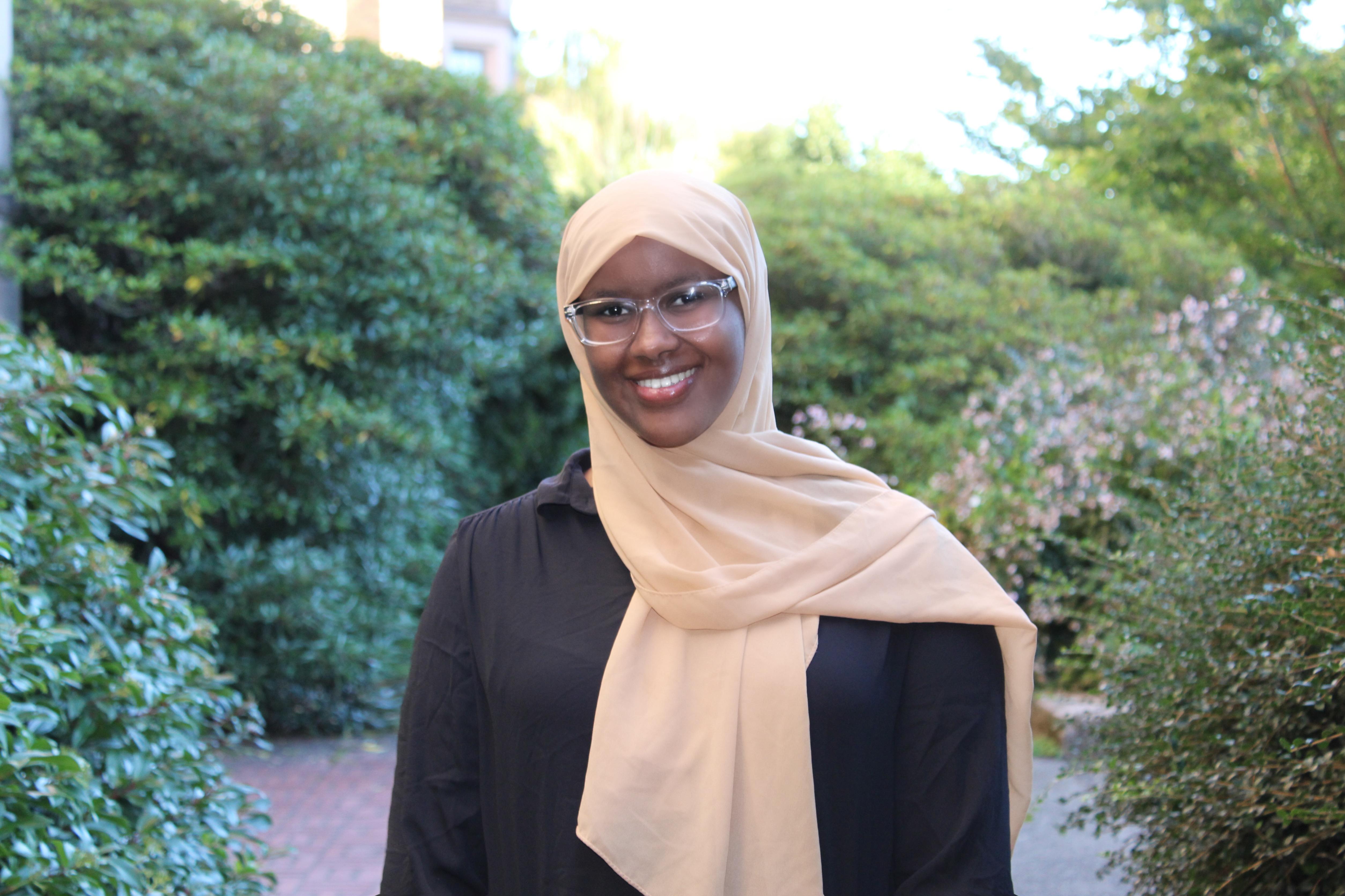 Najma Abdi, She / hers