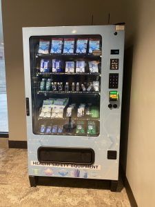 Vending machine with health and safety gear