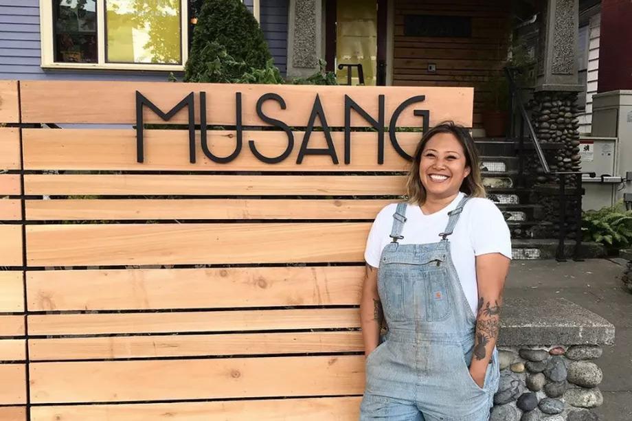 Melissa Miranda, '07 in front of her restaurant Musang