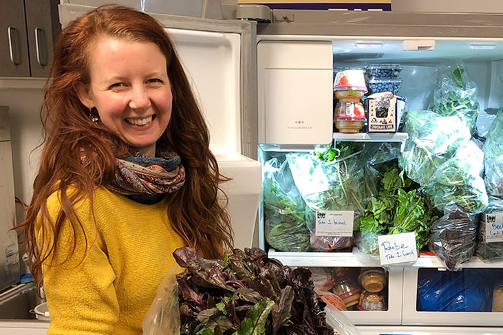 Alexandra Rochester standing in front of an open refrigerator