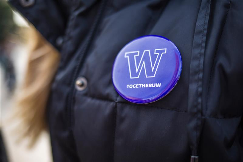 Together UW button pinned to a coat