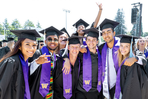 group of UW students in graduation caps and gowns