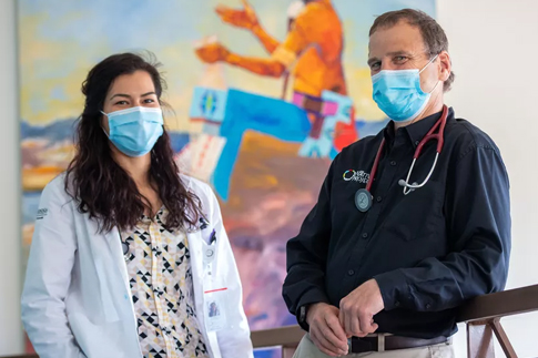 Kika Kaui and Dr. John McCarthy wearing blue masks
