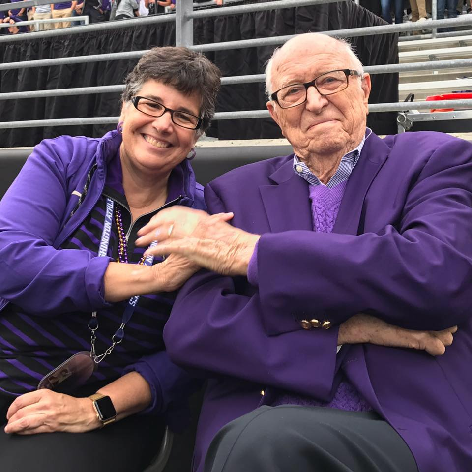 Photograph of Bill Gates Sr. with UW President Ana Mari Cauce at a football game in 2017