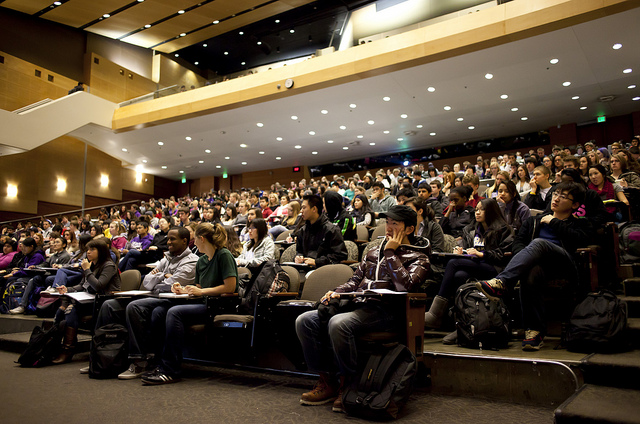 Large lecture hall filled with students in class