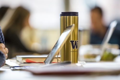 laptop with UW mug