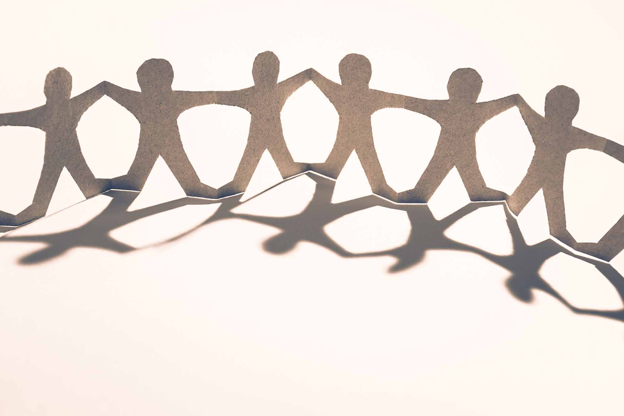 Figures linked & supporting each other