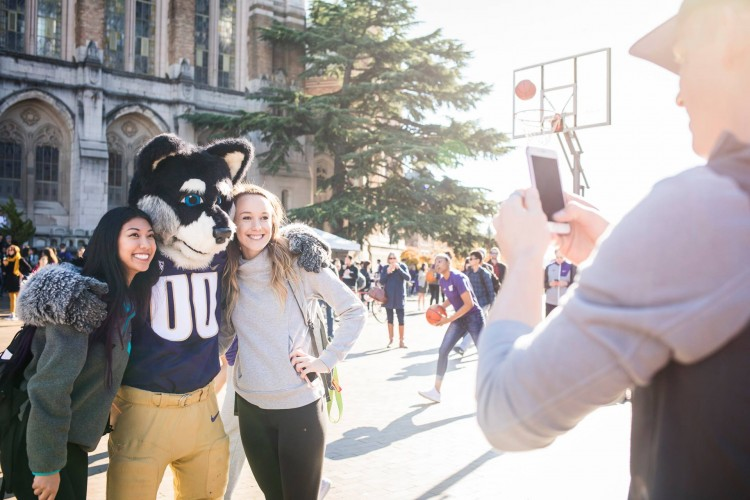 Harry Husky takes a photo with students on Red Square.