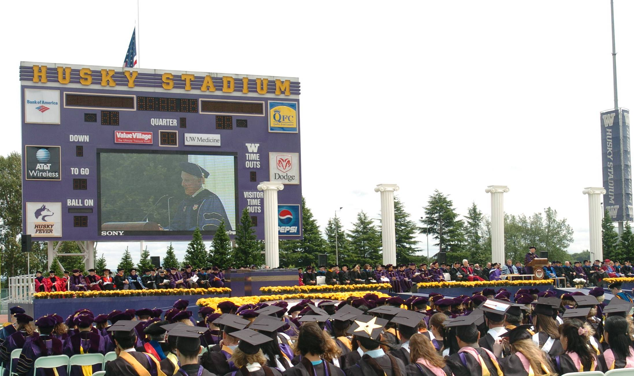 UW graduation in Husky Stadium with the four columns