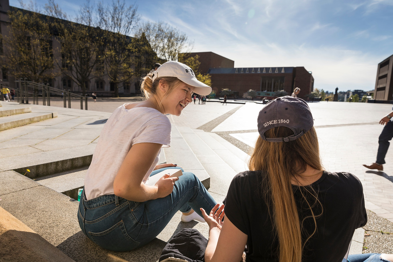 UW students enjoying the sun on the Suzzallo Library Stairs.