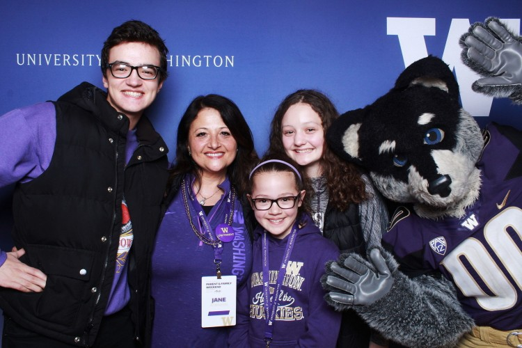 Harry Husky poses with participants at Parent & Family Weekend