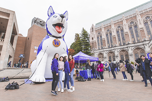 Students posing for photo in front of large inflatable Dubs