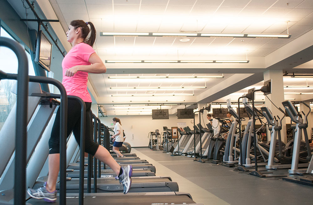 Women on treadmill in fitness center