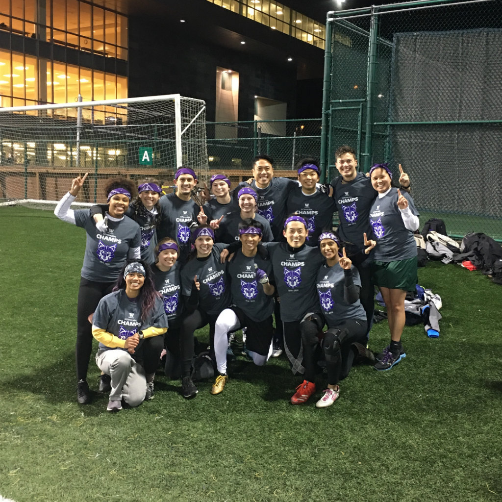 The autumn 2019 Intramural flag football champs are all smiles on the turf.