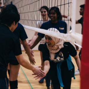 Players congratulate each other this fall after a game of intramural volleyball.