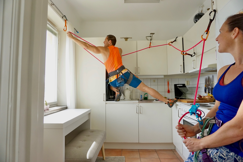 Nicole's partner Zamir rock climbs the kitchen cabinets.