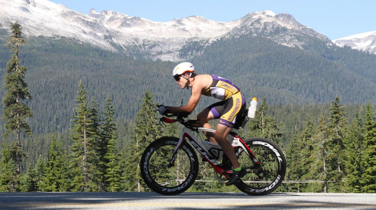 A UW triathlete bikes through the mountains.