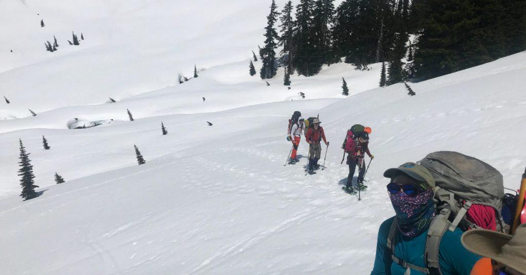 UW Recreation UWild participants snowshoe.