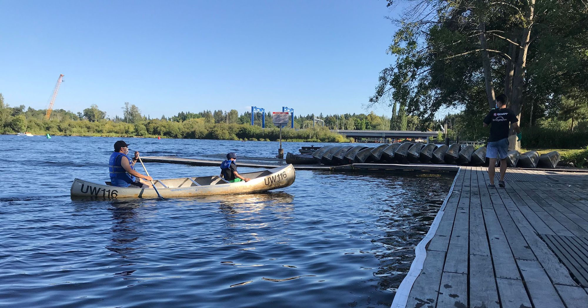 Masked participants enjoy time out on the water in a canoe rented from the Waterfront Activities Center.