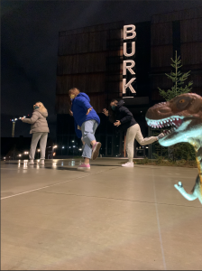 Participants feign running from a dinosaur at the Burke Museum.
