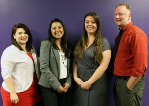 Portrait of 4 ETS staff members taken against a purple background, 3 women and 1 man