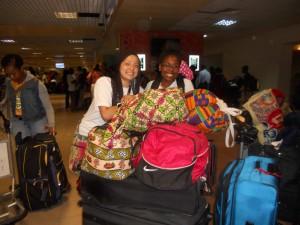 Avalon and Kamaria checking luggage