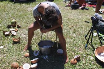 Kiana shredding the coconut