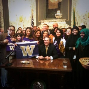 Huskies pose with Governor Inslee during the REAL Hope Act signing, Feb. 26.