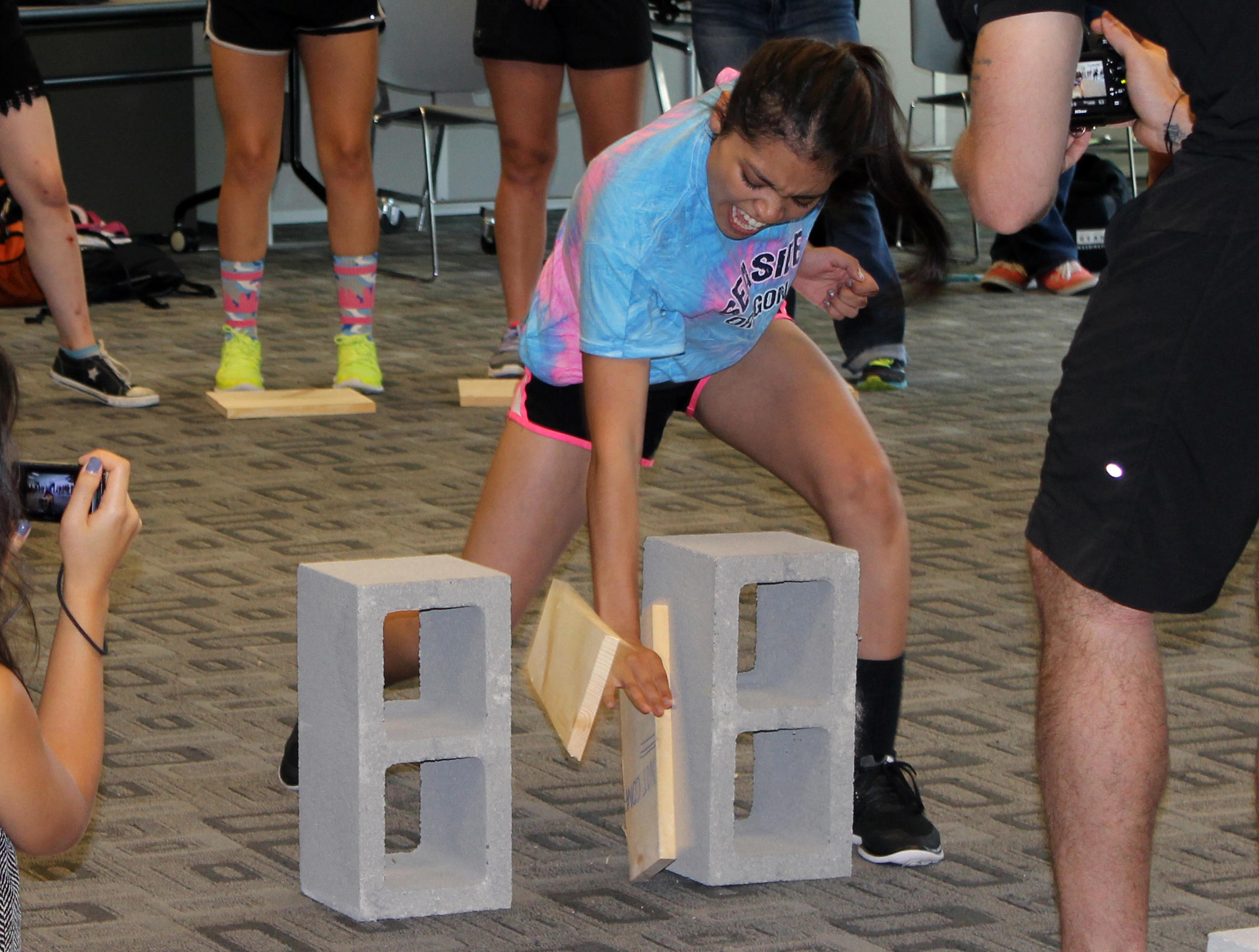 A final board breaking activity at the Leadership Camp helped students understand the concept of breaking through obstacles.