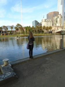 Hannah Olliges taking a picture of the Melbourne skyline