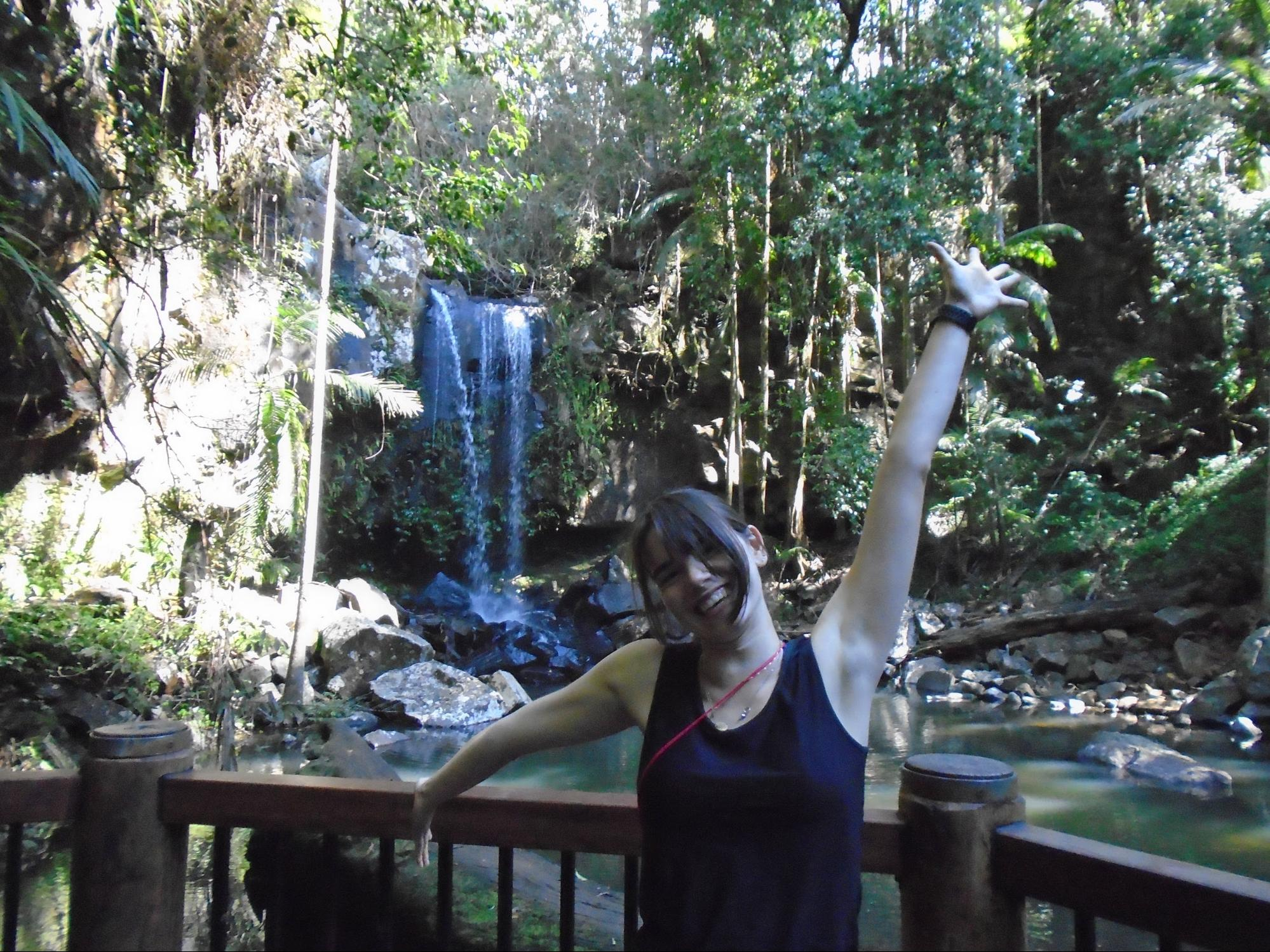 Your Author (Lara Millman) In front of a lagoon in the Tambourine Rainforest
