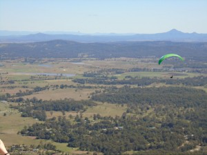 Parasailers jumping from a takeoff point near the glow worm caves