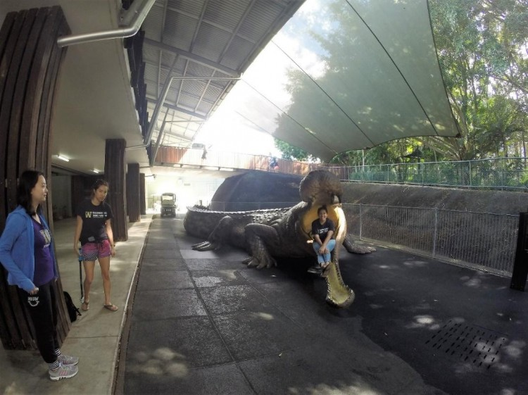 Yuliana taking a picture inside the giant crocodile as Tiffany, Jingyang and I stand by to take a group picture.