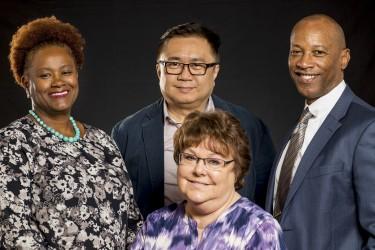 Award for Excellence Recipients: James Dorsey (executive director), Phyllis Harvey-Buschel (curriculum director/government relations), Lucy Casale (senior associate director) and Ku'ulani Seto (executive assistant)