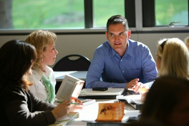 """Antony Smith, Assistant Professor, Education, UW Bothell with students. Photo by Brian DalBalcon."""