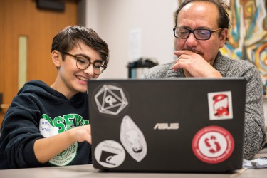 Students coding in classroom with UW President, Ana Mari Cauce