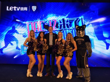 UW dancers and Harry the Husky with Pac-12 Commissioner Larry Scott at the announcement of a new agreement with China's Letv