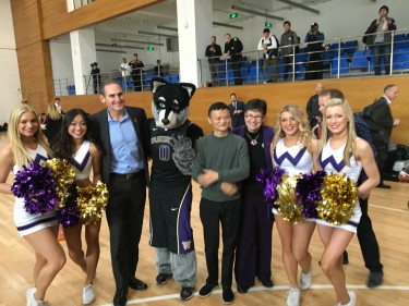 Jack Ma poses with Larry Scott, Ana Mari Cauce, UW dancers and Harry the Husky at Alibaba headquarters